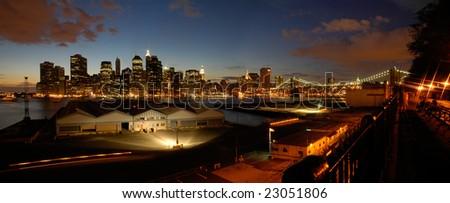 night panorama photo of lower manhattan, brooklyn bridge in picture - stock photo