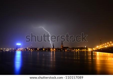 night panoramic scene in Riga during storm - stock photo