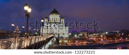 Night panoramic view of Moscow river, Sofia embankment and Moscow Kremlin in wintertime as viewed from riverside - stock photo