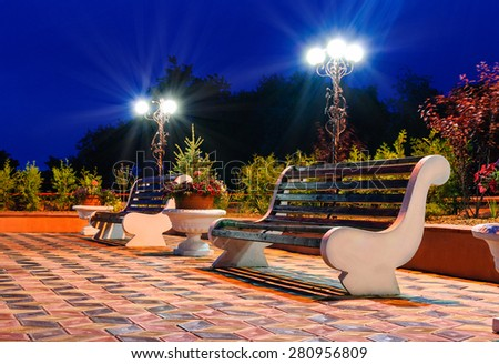 Night Park Wood Benches and Alley at summer - stock photo
