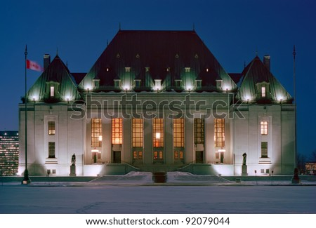 Night photo of front facade of the Supreme Court - stock photo