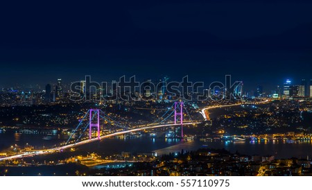 Night photo of iconic Bosphorus bridge and city of Istanbul, Turkey