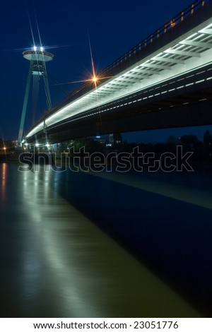 night photo of new bridge in bratislava, restaurant on top of the bridge - stock photo