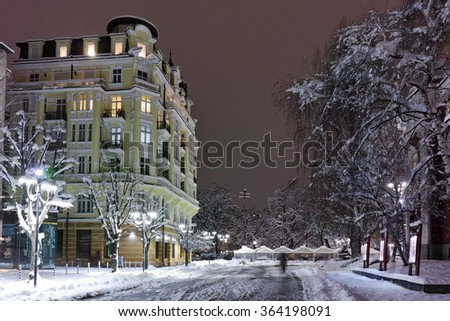 Night photo of snowy street in center of Sofia city, Bulgaria - stock photo