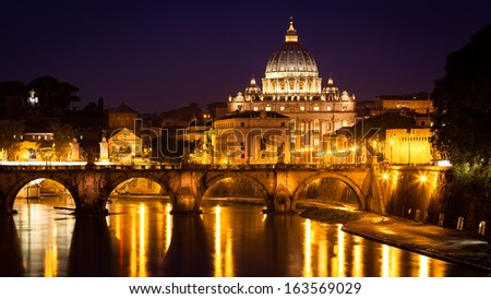 Night photo of St. Peter's Basilica, Ponte Sant Angelo and Tiber River in Rome - Italy. - stock photo