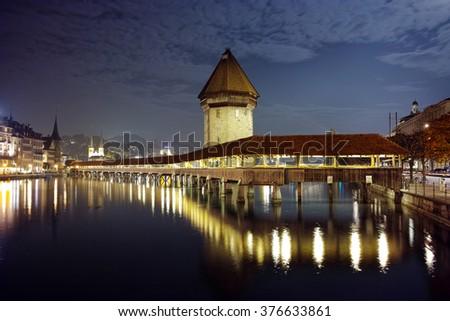 Night photos of Chapel Bridge in City of Lucern, Canton of Lucerne, Switzerland - stock photo