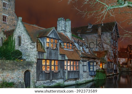 Night picturesque canal with beautiful medieval house in Bruges, Belgium - stock photo