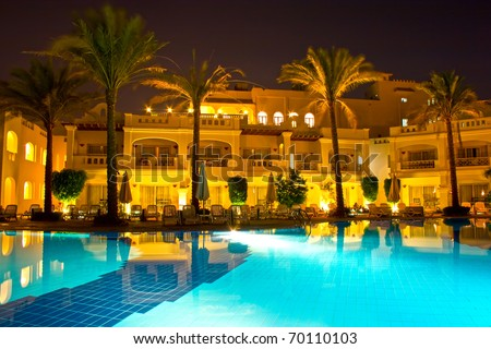 Night pool side of rich hotel (trademarks were removed) - stock photo