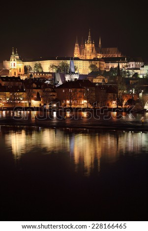 Night Prague gothic Castle and St. Nicholas' Cathedral with Charles Bridge, Czech Republic - stock photo