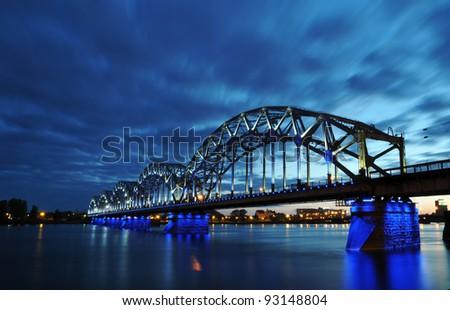night railway bridge in Riga - stock photo