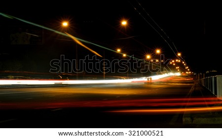 Night road in the city with car the light trails  - stock photo