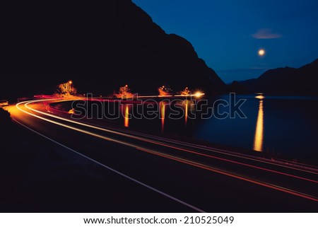 Night road, mountain and Lake - stock photo