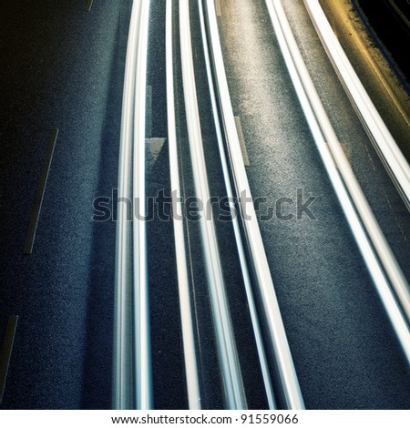 Night road with car lights traces. - stock photo