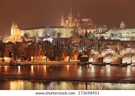 Night romantic snowy Prague gothic Castle and St. Nicholas' Cathedral, Czech republic