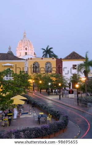 night scene car light streaks  of square restaurant Naval Museum Iglesia Church of Santo Domingo Cartagena de Indias Colombia South America - stock photo