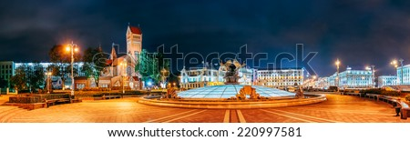 Night Scene - Church Of Saints Simon And Helen (Red Church) Is Roman Catholic Church On Independence Square In Minsk, Belarus. Panoramic Shot. This Neo-Romanesque Church Built During 1905-1910 - stock photo