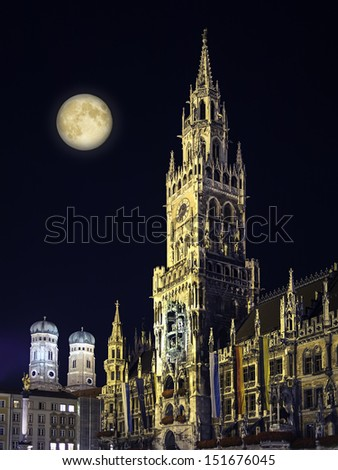 Night scene from Munich Town Hall and Frauenkirche with moon in Germany Bavaria - stock photo