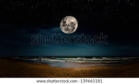 Night scene. Full moon reflected on the sea. - stock photo