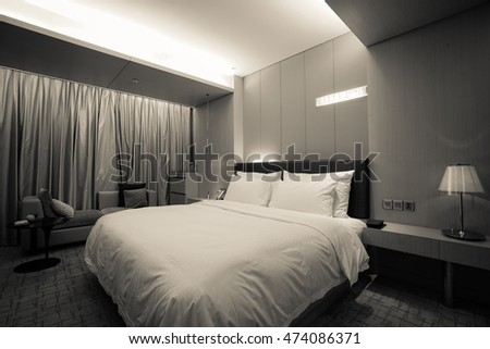 Night scene in hotel room, nightstand with lamp