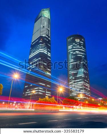 Night scene in Madrid business district - stock photo