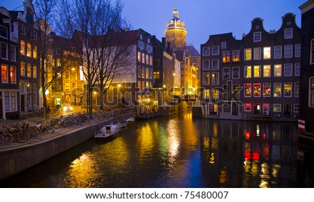 Night scene in one of the multiple canals in Amsterdam - stock photo