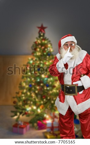 Night scene of a Christmas tree with Santa Claus - stock photo