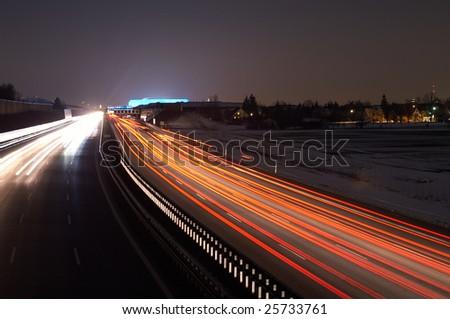 Night scene of Allianz Arena and traffic - stock photo
