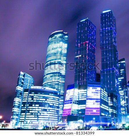 night scene of beautiful illuminated colorful skyscrapers