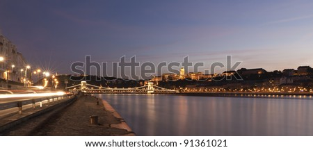Night scene of Budapest, with the famous chain bridge, and royal palace - stock photo