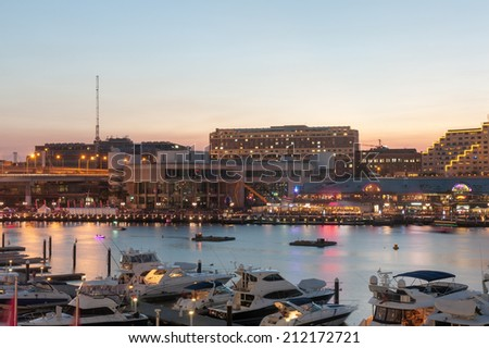 Night scene of Darling Harbour, adjacent to the city centre of Sydney and also a recreational place in Sydney central business district - stock photo