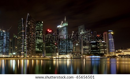 Night scene of financial district,Singapore. From the river. - stock photo
