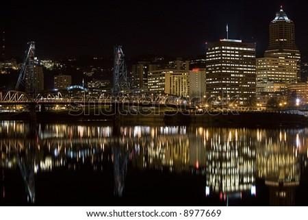 Night scene of Hawthorne Bridge and Downtown Portland Oregon - stock photo