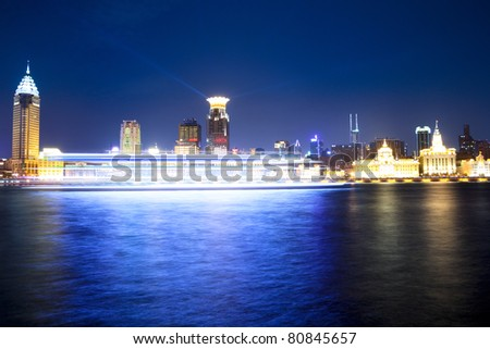 night scene of huangpu river in shanghai, classic historical buildings and modern  buildings on the bund,China