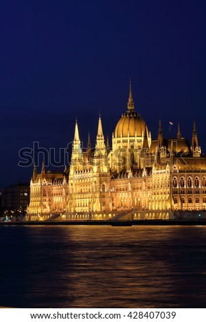 Night scene of Hungarian Parliament Building along Danube River in Budapest - stock photo