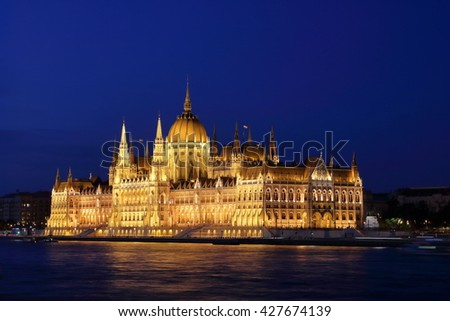Night scene of Hungarian Parliament Building at the Danube River bank, viewed from the Chain Bridge, Budapest - stock photo