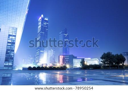 night scene of modern city at  shenzhen special economic zone,China - stock photo