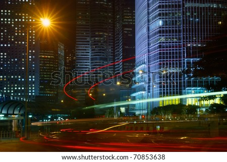 Night scene of modern city with cars motion blurred.