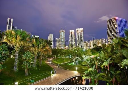 Night scene of modern city with park in Kuala Lumpur, Malaysia, Asia. - stock photo