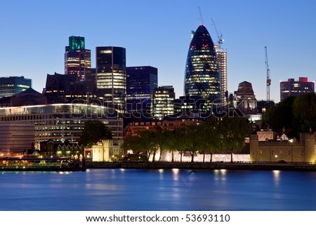 night scene of modern London city skyline of business district along River Thames near the Tower Bridge - stock photo