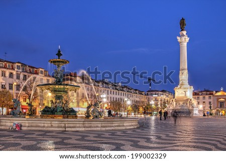Night scene of Rossio Square, Lisbon, Portugal with one of its decorative fountains and the Column of Pedro IV. - stock photo