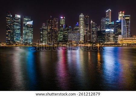 night scene of Singapore skyscraper at marina bay - stock photo