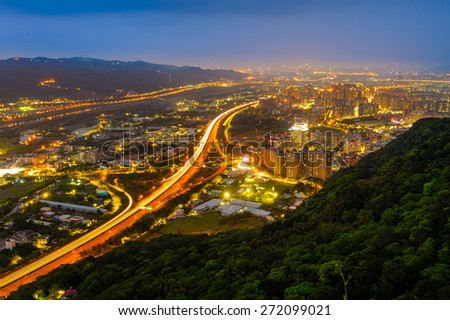 night scene of Taipei with traffic trails - stock photo