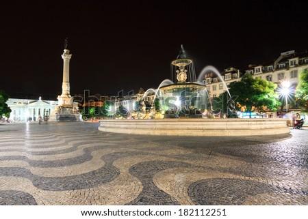 Night scene of the beautiful Pedro IV square in Lisbon, Portugal - stock photo