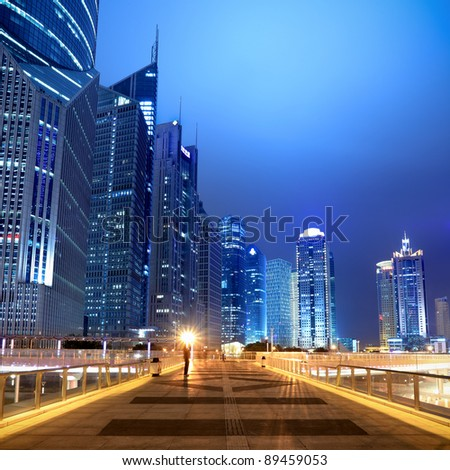 night scene of the modern building background on the flyover in shanghai - stock photo