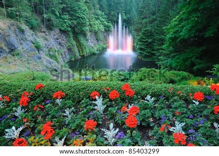 night scene of the ross fountain inside the historic butchart gardens, victoria, british columbia, canada - stock photo