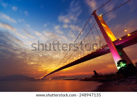 Night scene of Tsing Ma Bridge with illuminated light in Hong Kong, Asia. - stock photo