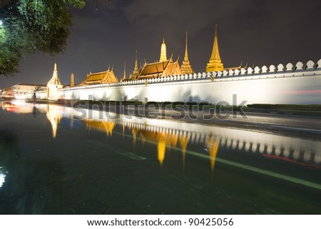 night scene of Wat Phra Kaeo at the Grand Palace in Bangkok, Thailand. - stock photo
