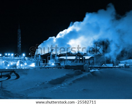 Night scene on  a oil refinery station. Winter frost - stock photo