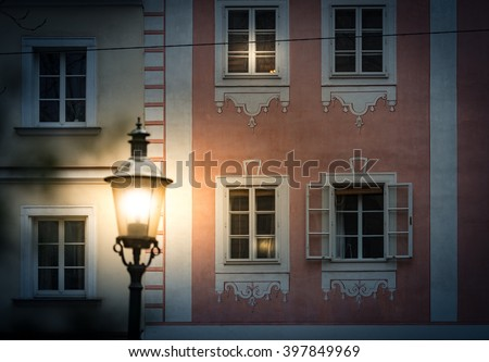 Night scene on street of Vienna, Austria. Glowing lantern in foreground with traditional architecture as main subject. Europe travel.