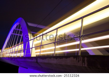 night scene with commuter train - stock photo